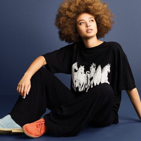 Fashion model wearing horse themed tshirt and mismatched shoes