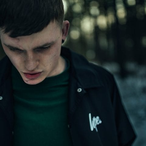 Fashion model wearing Hype clothing in dark forest