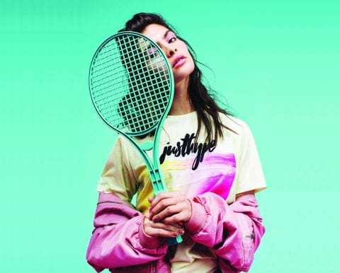 Fashion model wearing Hype clothing, holding tennis racket