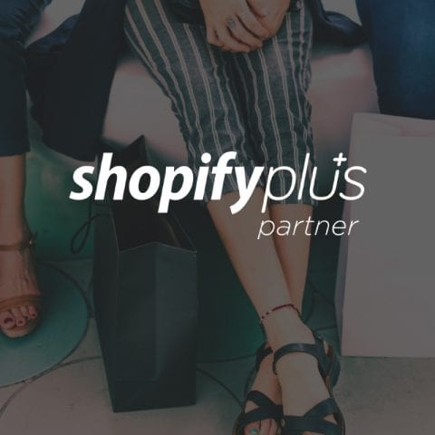Shopify Plus logo, with ladies' legs and shopping bags in background