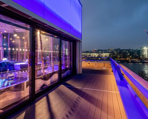 The Deck, glassed-walled terrace, with view of River Thames in the background