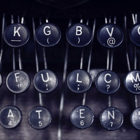 A closeup of a black typewriter