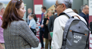 People talking at a PHES event